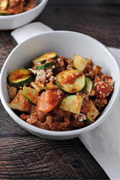Zucchini casserole with ground beef in a white bowl