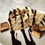 no bake snickers pie on a white plate
