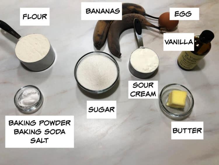 banana bread ingredients: flour, bananas, egg, vanilla, sour cream, sugar, baking powder, baking soda and salt