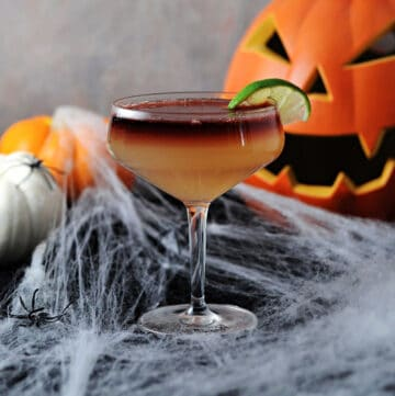 Devil's Margarita surrounded by Halloween themed decorations