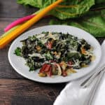 roasted swiss chard on a white plate ready to eat